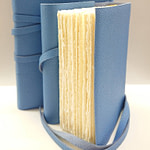 Light blue leather journal with ivory Amalfi paper inside pages.