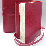 Red leather notebook fully hand bound with Amalfi paper inside pages