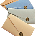 Amalfi paper gift boxes. Each pack contains 10 sheets 13x8 and 10 envelopes 14x9 enclosed by a sheet of LR line sealed with sealing wax. Available in different colors.
