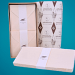 BOX WITH SQUARE FOLDING SHEETS IN AMALFI PAPER. COLOR: IVORY PINK