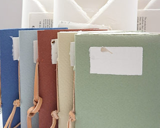Amalfi paper gift box containing stationery with associated envelopes and a hand-bound notebook with cover in a color of your choice.